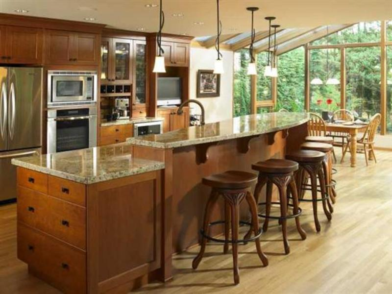 Kitchen islands with room to spare for Kitchen designs island